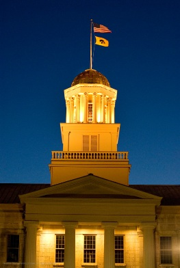 The golden dome atop the Old Capitol Building at night.