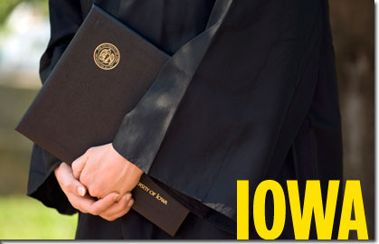 Close up of Iowa graduate holding their diploma.