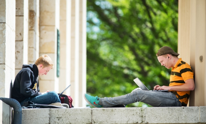 Students work outside during nice spring weather on campus