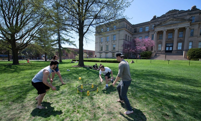 Students playing games on the lawn in front of Schaeffer Hall